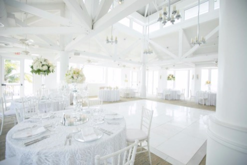 photo of an all white decor reception set up at the marquesa ballroom at the hyatt centric