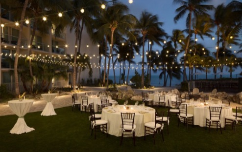 reception set up in the grass at amara cay resort